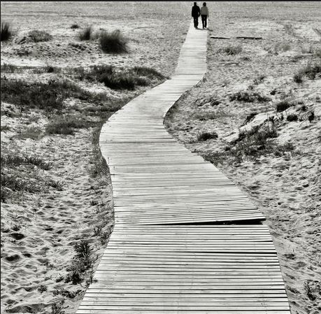 couple walking to the end by Jesus Leon