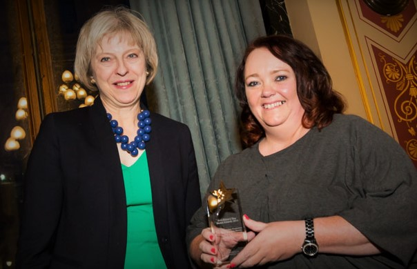 Home Secretary Theresa May presenting the award to Clare O'Brien of Ten Ten Theatre